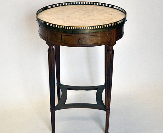 Lot 540: 19th cent Louis XVI walnut? ''Bouillot'' round center table with marble top and brass gallery. H76 x dia 54cm.