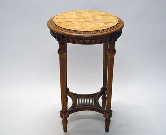 Lot 545: Louis XVI style marble top round center table with caned stretcher. H 72 x dia.45cm.