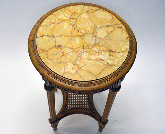 Lot 545_1: Louis XVI style marble top round center table with caned stretcher. H 72 x dia.45cm.