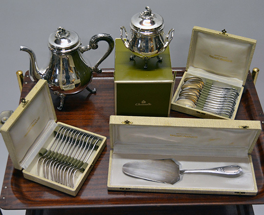 Lot 556: Christofle silver plated tea pot and sugar bowl plus two sets of (dessert) forks & spoons and cake knife.